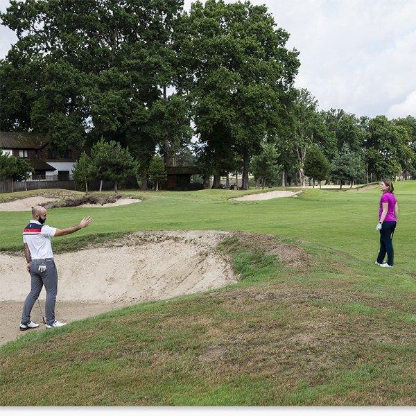 Golfer Waving Playing Partner Ahead