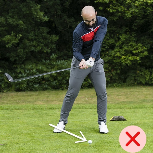 Hitting down on ball with driver